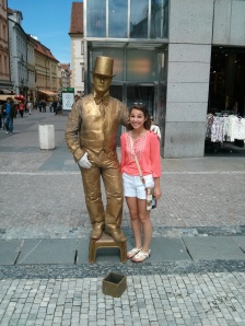 Alexis is making friends at Wenceslas Square.