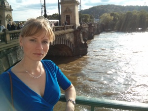 Mrs. Tallman observing the flooded Vltava River before the opera.