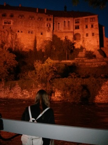 Anna studies the castle in Cesky Krumlov.