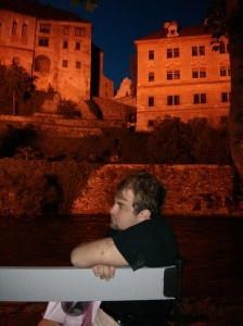 Brett under the castle at night in Cesky Krumlov.